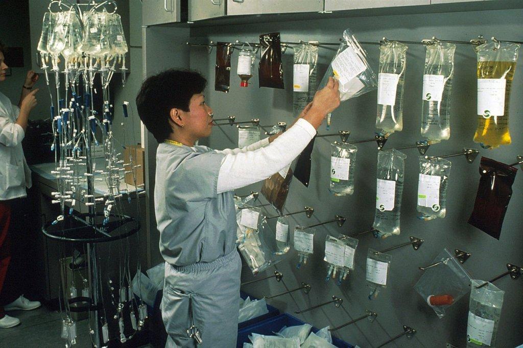Nurse hanging chemotherapy drugs