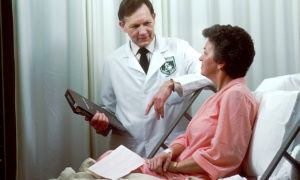 Oncology doctor checkingup on patient