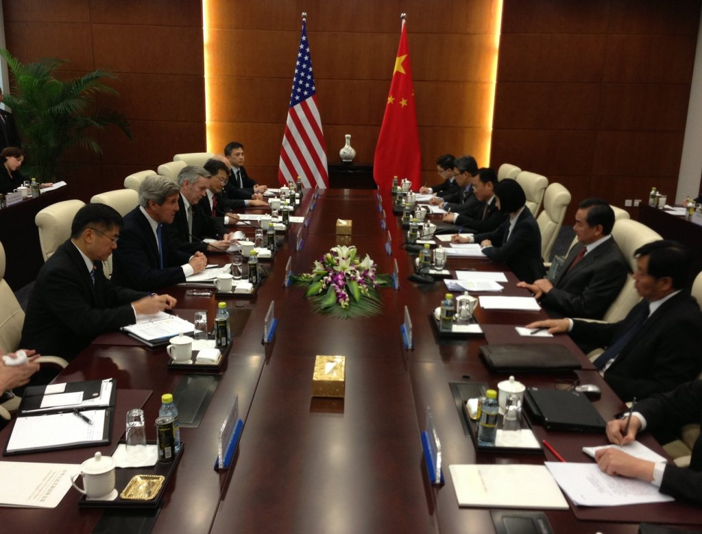 U.S. Secretary of State John Kerry speaks with Chinese Foreign Minister Wang Yi at the beginning of a bilateral meeting in Beijing, China, on April 13, 2013. (Source)