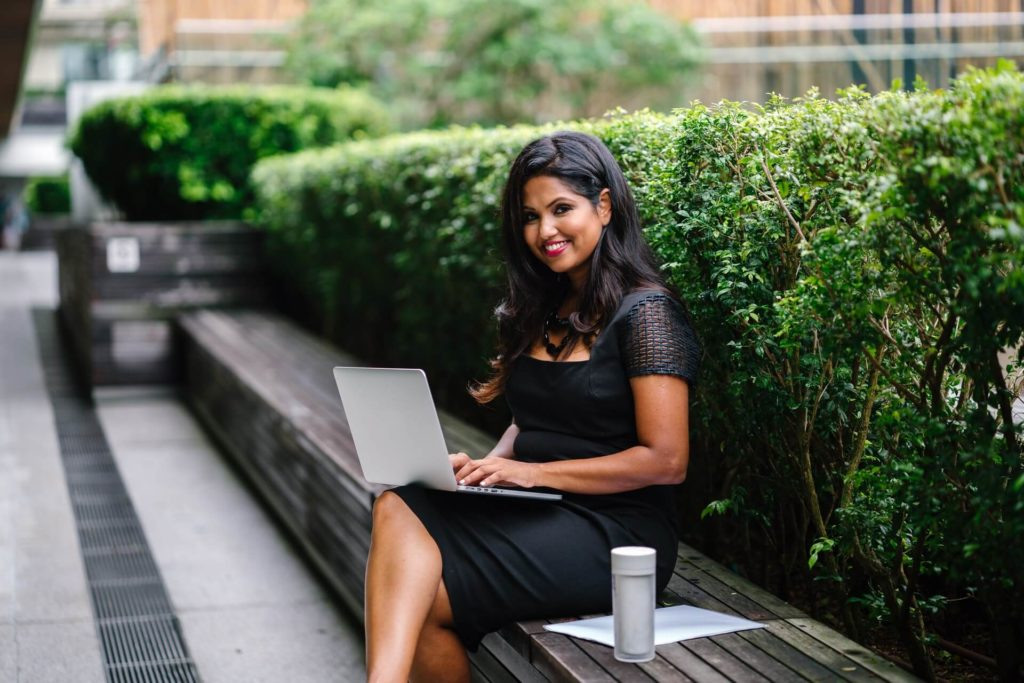 woman working outside on laptop