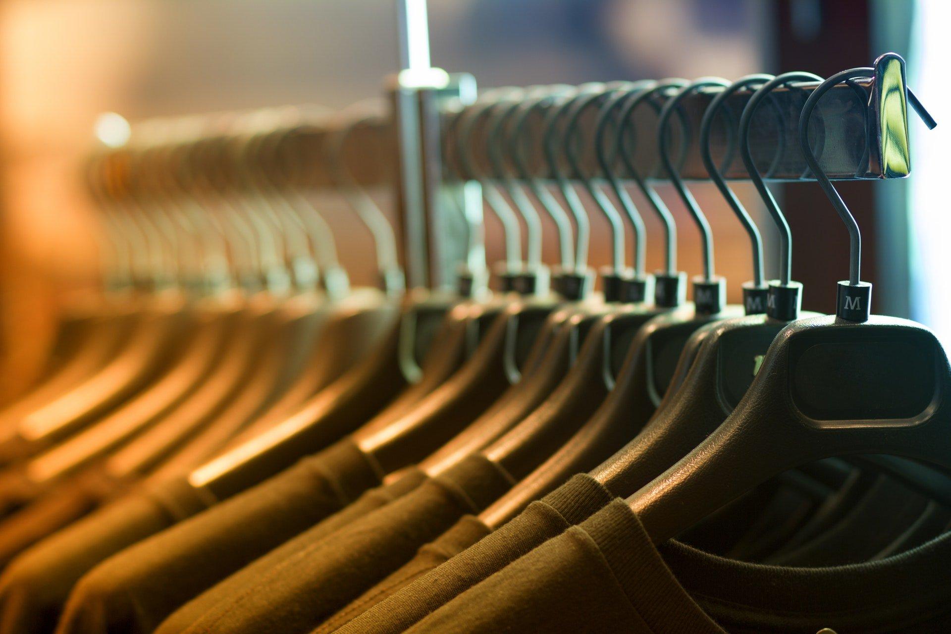 T-shirts hanging in shirt rack