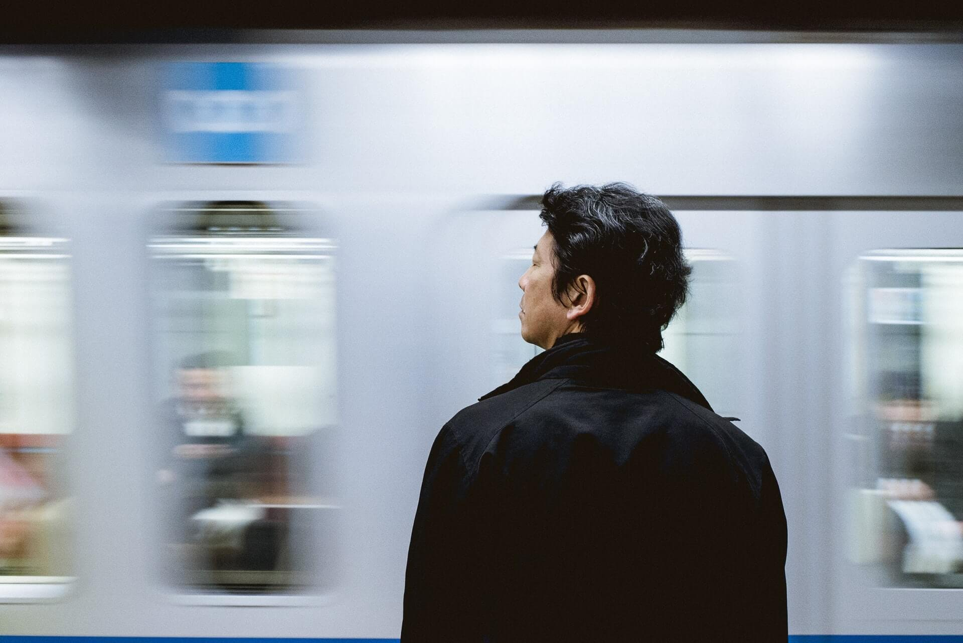 Man in front of train
