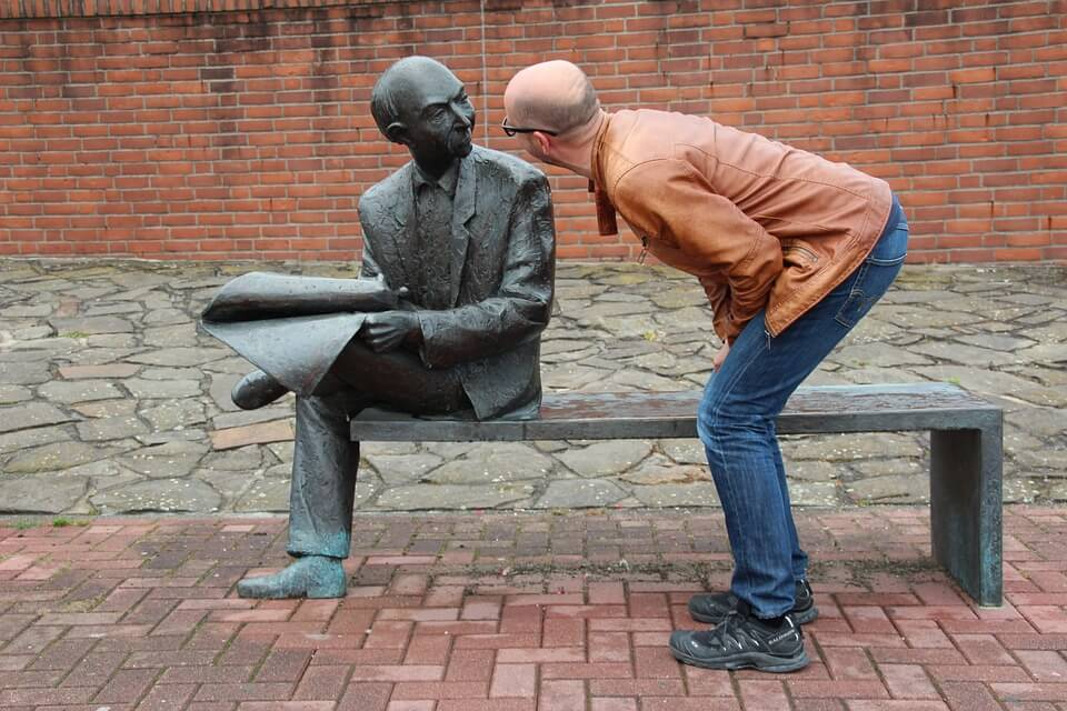 A man questioning a statue, questions every entrepreneur should ask