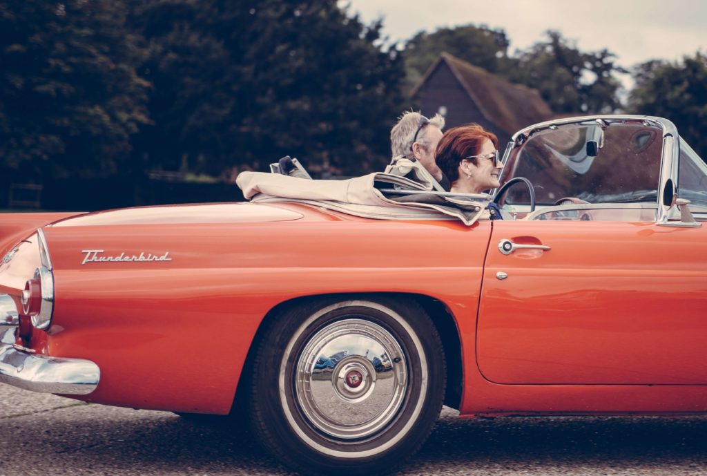 retirees in vintage car