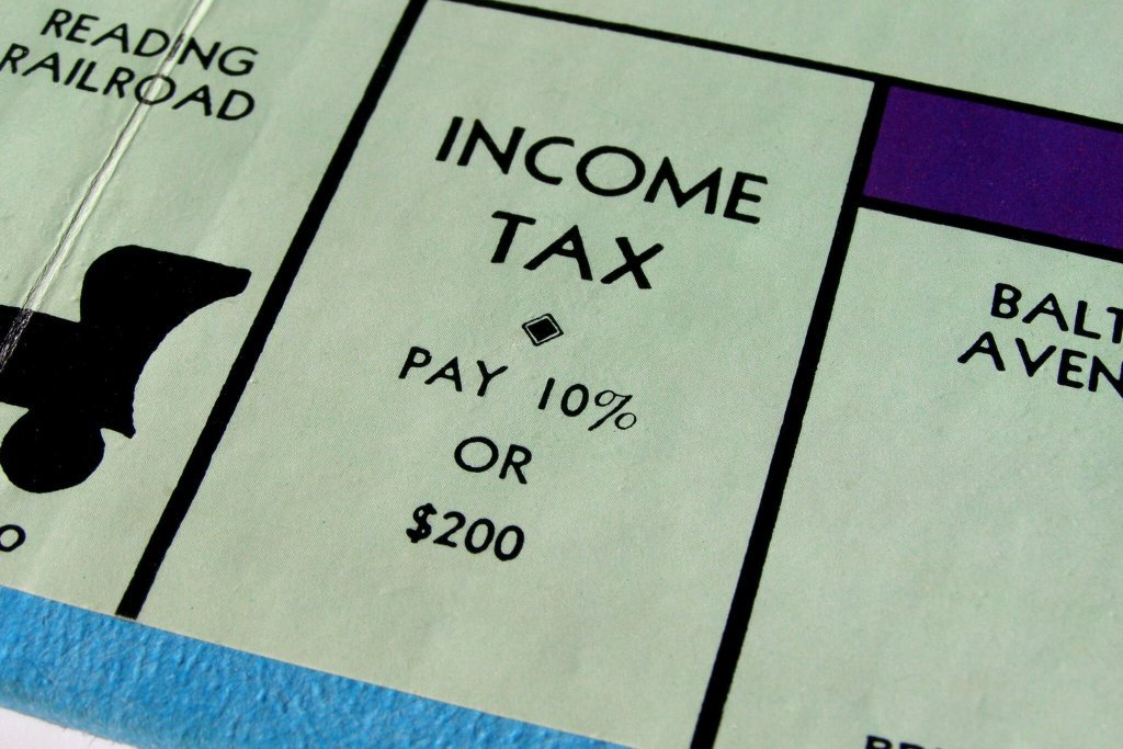 Income Tax on Monopoly board game, save for retirement