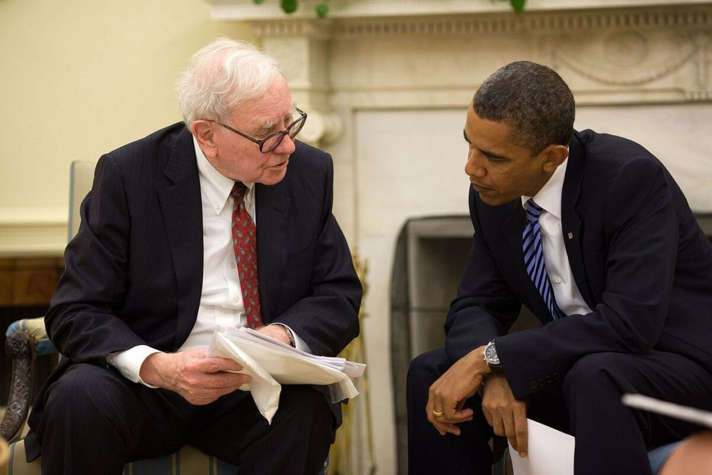 Warren Buffett with former President Barack Obama. warren buffett cash