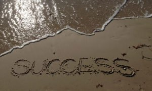 Success written on sand