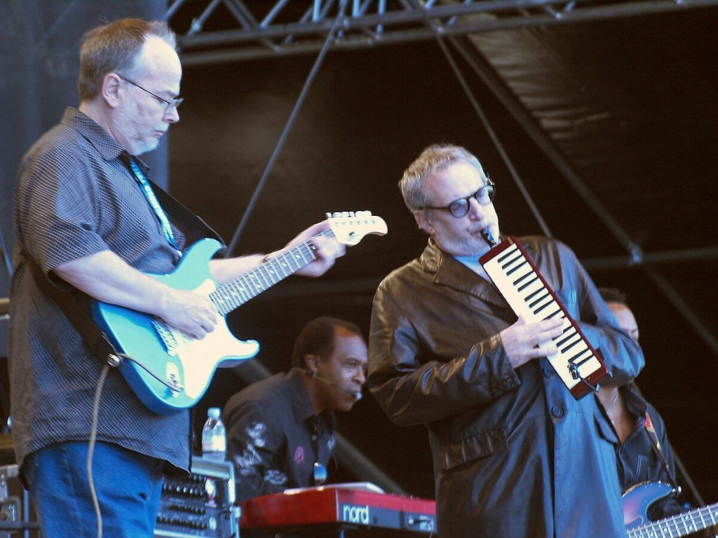 Steely Dan performing on stage.