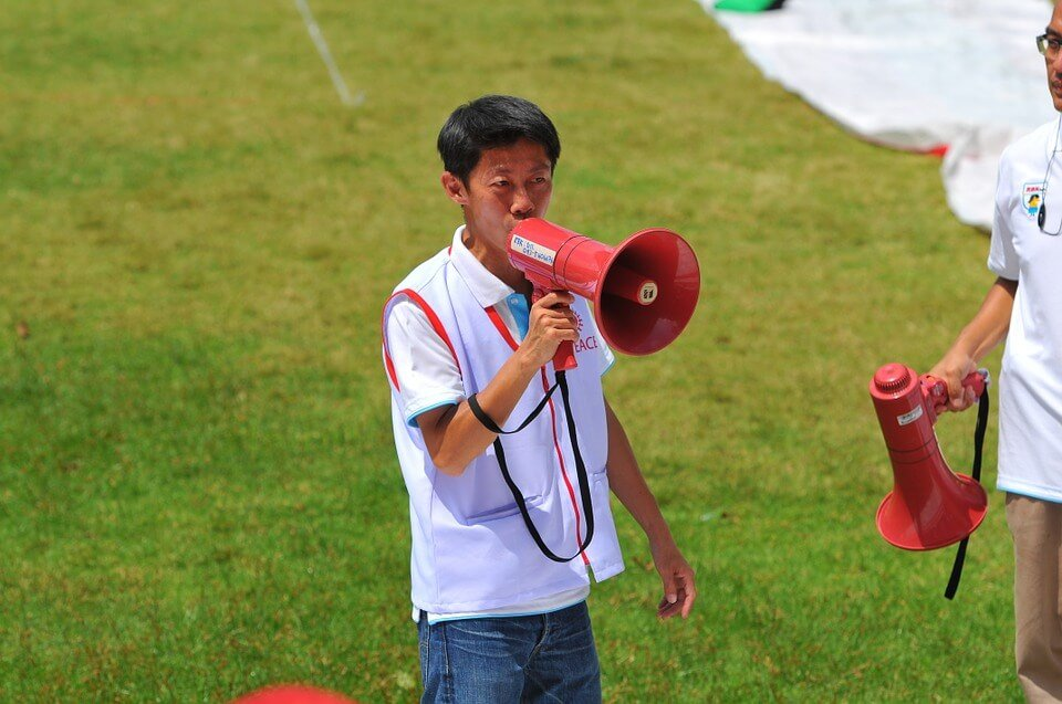 "workplace productivity"" Man with megaphone."