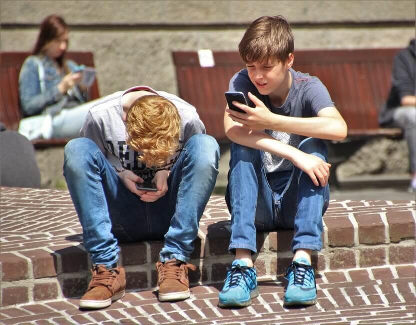 digital growth: boys using mobile phones.