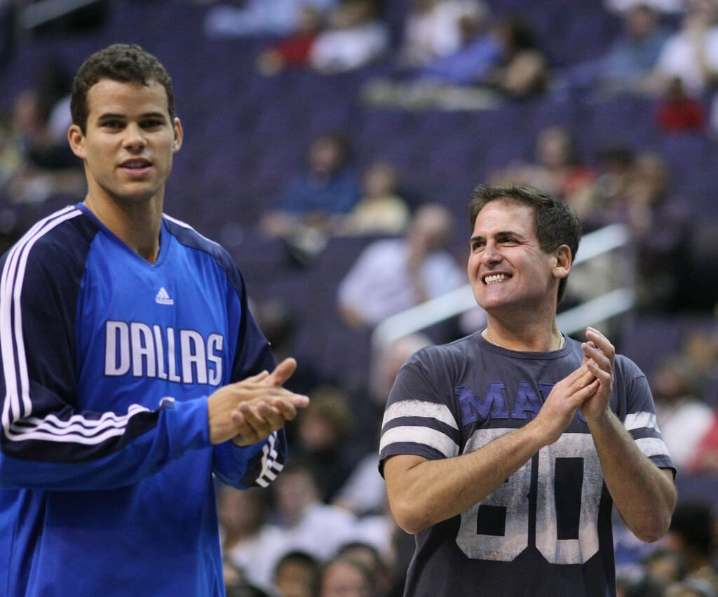 Mark Cuban with a Maverick player.