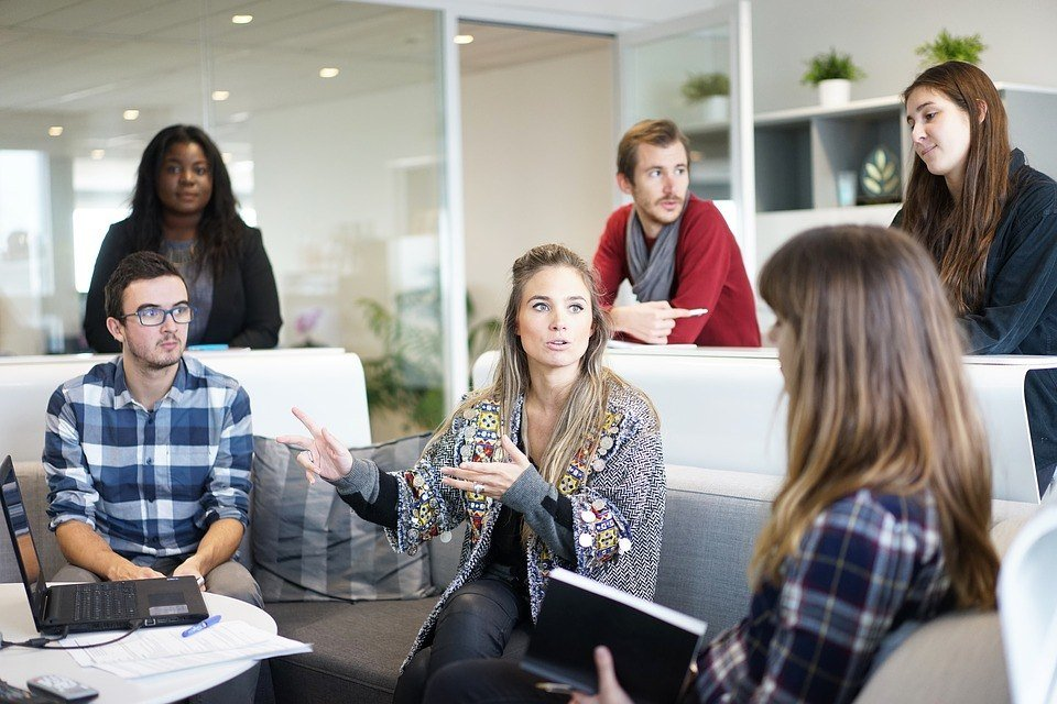 Female social entrepreneur taking charge in a meeting