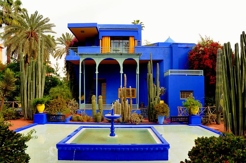 The striking colors of Jardin Majorelle makes an avant garde pop to the Moroccan museum. Not only does it house the Berber Museum but the Yves Saint Lauren Museum as well. (Photo by Viault via Wikimedia Commons. CC BY-SA 3.0)