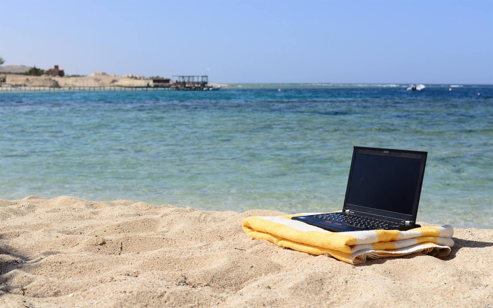 laptop by beach
