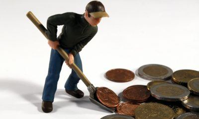 toy figure shovelling coins