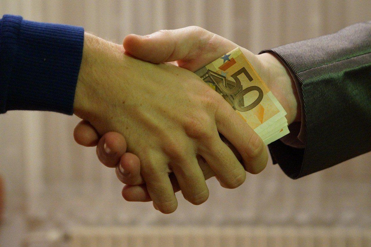 euros shaking hands