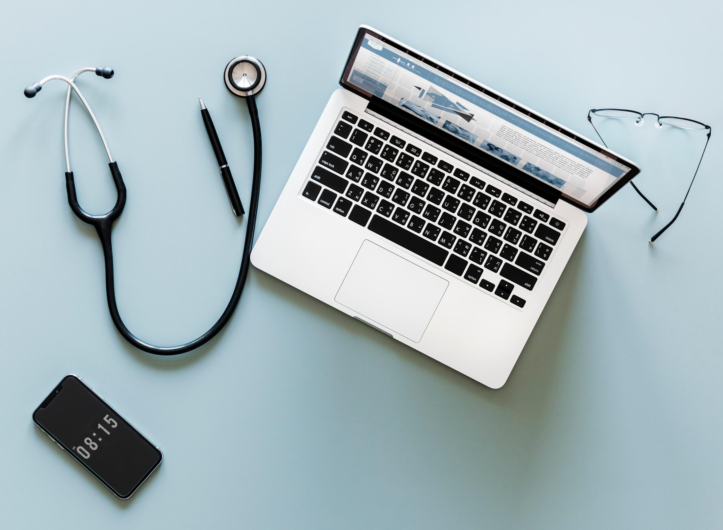 laptop flatlay stethoscope