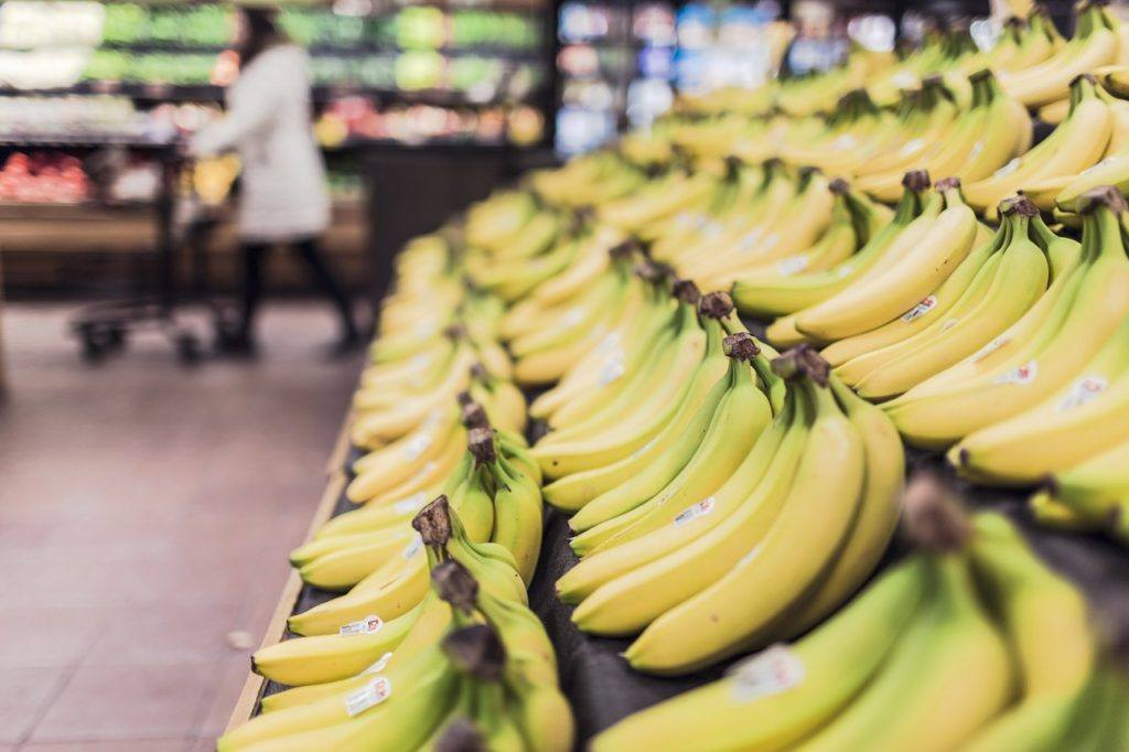 This picture show bananas being sold in a supermarket.
