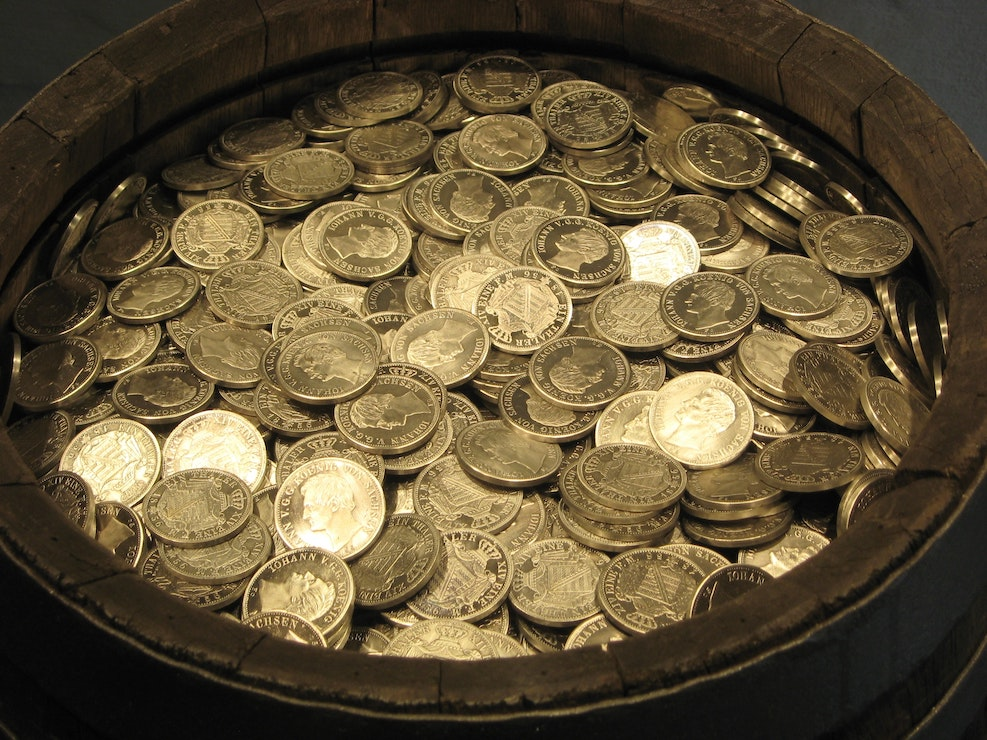 This picture show a jar full of coins, representing the money investment of any individual.