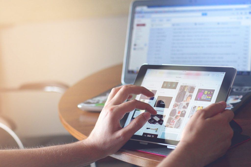This picture show a person using a tablet.