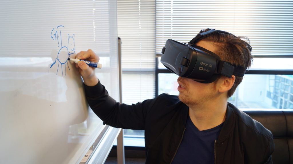 This picture show a person using a VR gear.