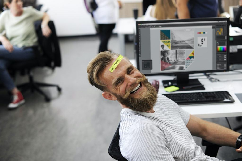 This picture show a happy man while working