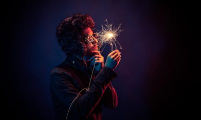 This picture show a guy holding a spark, representing innovation.