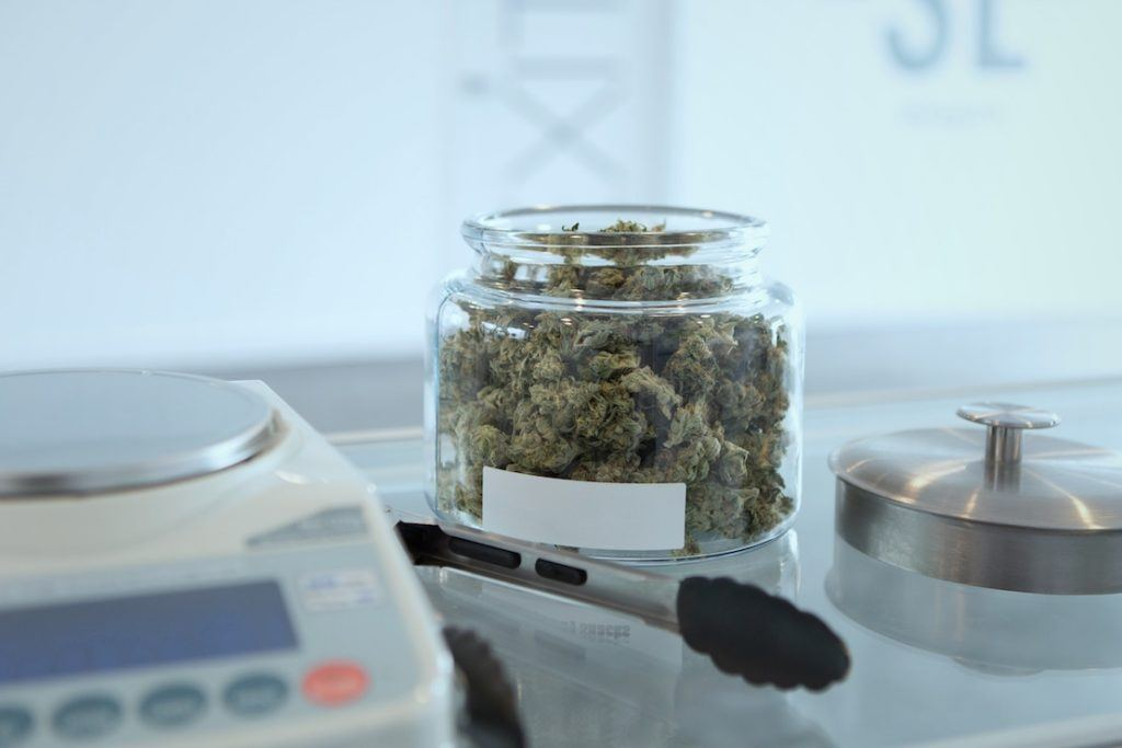This picture show a cannabis product on top of a glass counter.