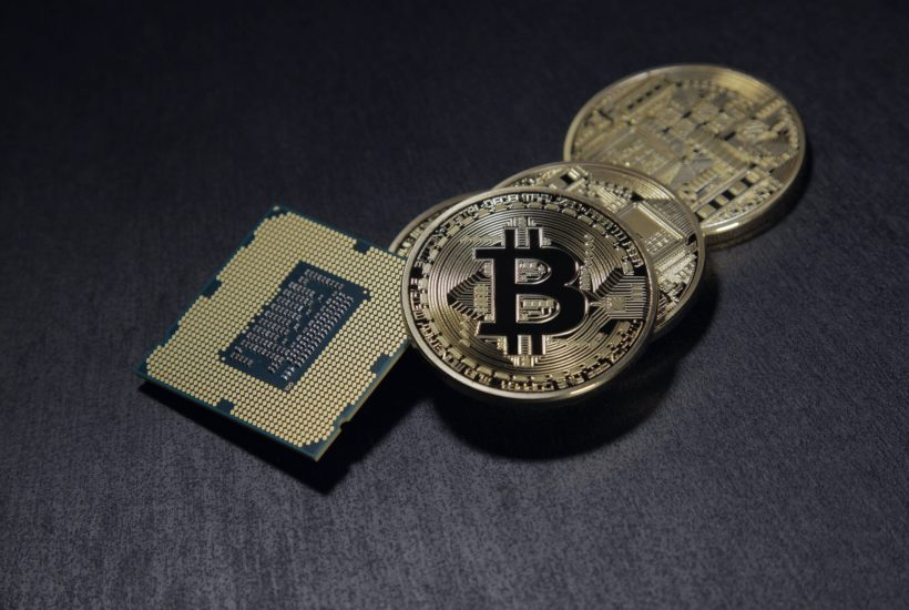 This picture show a bitcoin and a processor, represent crypto services
