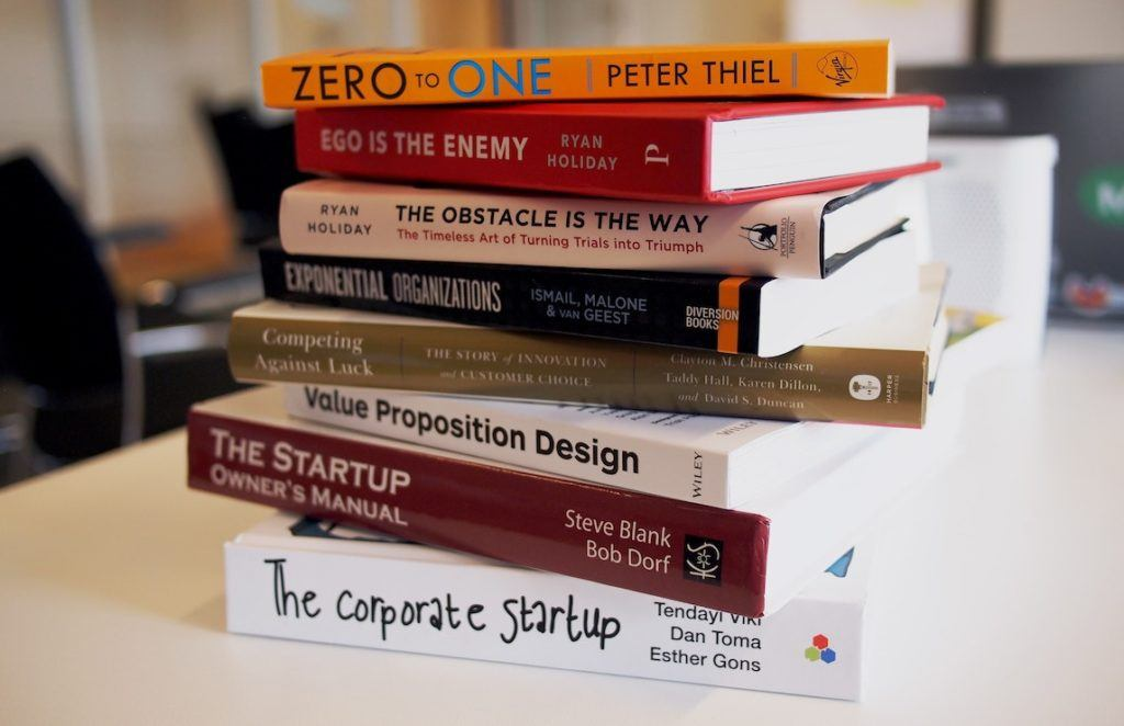 This picture show a pile of entrepreneur books.