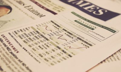This picture show a newspaper with stock market information.