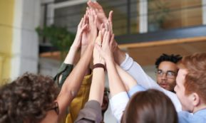 This picture show a group of people clapping hand.