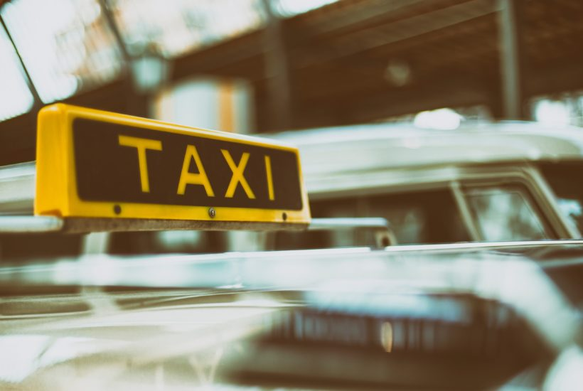 This picture show a taxi sign.