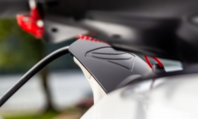 This picture show an electric car charging.