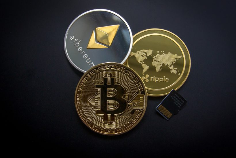 This picture show a couple of cryptocurrencies stacked up.