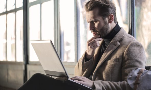 This picture show a person using a laptop.