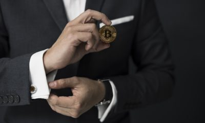 This picture show a fintech entrepreneur holding a cryptocurrency.