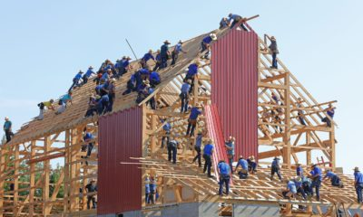 This picture show a group of people building a house.
