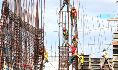 This picture show some workers on a building site.
