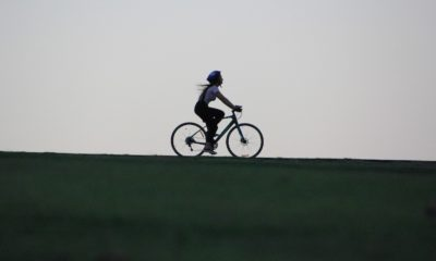 This picture show a person riding an electric bicycle.