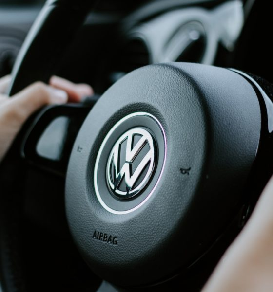 This picture show a person holding a Volkswagen wheel.