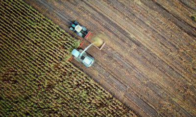 This picture show a truck working on a farm.