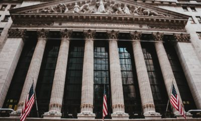 This picture show the front of wall street stock market.