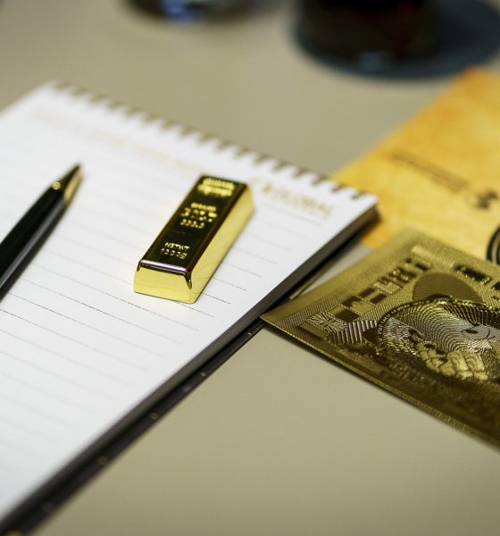 This picture shows a gold bar on top of a notepad.