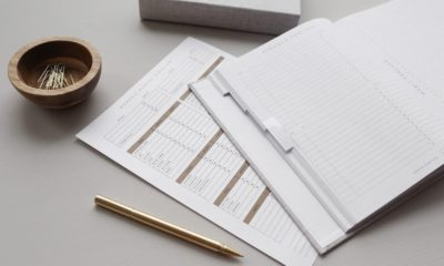 This picture shows some papers on a desk.