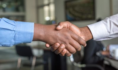 This picture show two person doing a handshake.