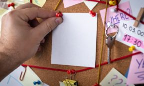 This picture show a blank paper being put on a board.