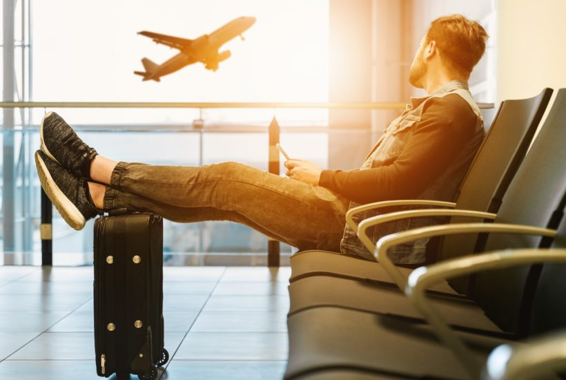 This picture shows a person waiting on an airport.