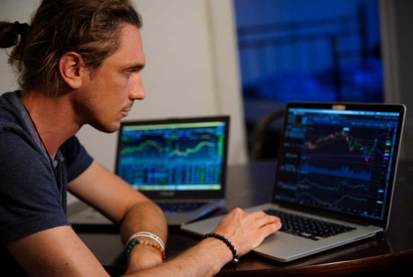 This picture shows a person looking at some stock market data.