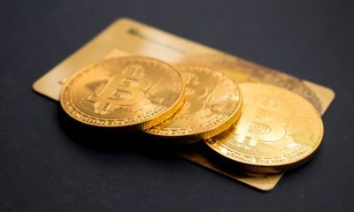 This picture shows a couple of bitcoins on top of a card.